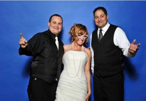 A fun bride and groom with an Interactive wedding photo booth with Colorado wedding DJ Matt Martindale