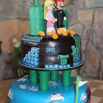 A custom wedding cake at Taharaa Mountain lodge in Estes Park featuring Super Mario for another Colorado destination wedding