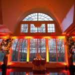 Vibrant wedding uplighting to showcase architectural features
