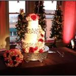 An elegant wedding cake with up-lighting in this Colorado wedding venue in Colorado Springs