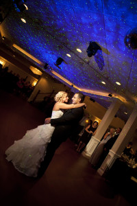 A happy Bride and Groom dancing under the starts in a hotel ballroom