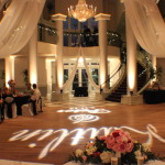 Elegant wedding up-lighting with wedding fabric by Colorado wedding lighting company Amore lighting and décor at the Denver wedding venue Chateaux at Fox Meadows