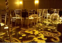 An elegant wedding reception with custom wedding lighting, paisley patterns and chiavari chairs for this beautiful wedding