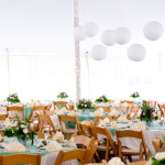 An outdoor tent wedding in Fort Collins with paper lanterns and tent lighting