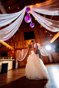 "Romantic first dance at Colorado wedding venue ""the Big Red Barn"" at the Highland Meadows Golf Course captured by Colorado wedding Photographer, Tom K."