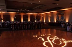Custom wedding up lighting with a custom wedding monogram